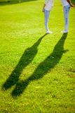 Shadow of Couple Kissing on Grass royalty free stock images