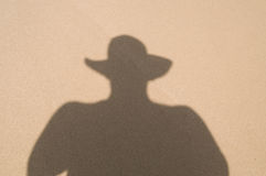 Shadow of cowboy in hat Stock Photo