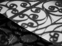 Shadow of curved steel window decoration shading on marble floor Stock Images