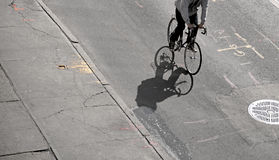 Shadow of cyclist Royalty Free Stock Photos