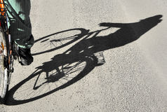 Shadow of cyclist Stock Photography