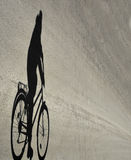 Shadow of cyclist Royalty Free Stock Photography