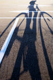 The shadow of a cyclist on the pavement arrow direction Stock Photo
