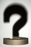 shadow of a 3d question mark stock images