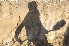 Shadow digger Stock Photos
