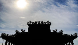 Shadow Dragon. On the roof of the temple and sun Royalty Free Stock Photos