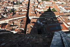 Shadow of the Duomo over rooftops of Florence Stock Images