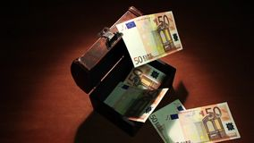 Shadow economy. 50 Euro. Money falls in the ancient chest. 50 Euro banknotes. Artistic dark background. stock footage