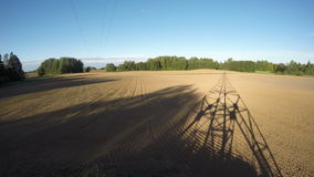 Shadow of electrical pylon on the fields, time lapse 4K stock footage