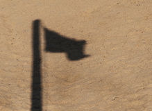 The shadow of the emerging flag in the sand Stock Photos