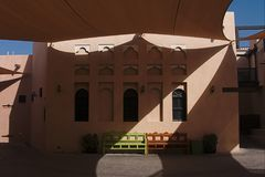 Shadow on the facade of a typical Arab building, in Katara, the cultur. A tensile structure stretched over a courtyard projects the shadow on the facade of a Royalty Free Stock Photo
