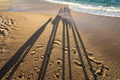 Shadow of a family on the beach Stock Photography
