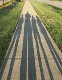 Shadow of Family Walk Royalty Free Stock Images