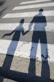 Shadow of father and child by the road Royalty Free Stock Photos