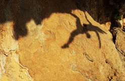 Shadow of a female rock climber Royalty Free Stock Images