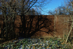 Shadow on the fence Royalty Free Stock Photography