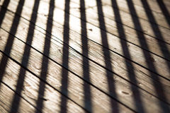The shadow of the fence on the old wood Royalty Free Stock Photography