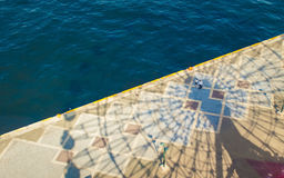 Shadow of Ferries Wheel on Ocean Body of Water at Day Time Royalty Free Stock Photo