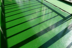 Shadow of the ferry railing Stock Photography