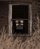 Shadow Figure. Creepy shadow figure through old worn out window of building Stock Photography
