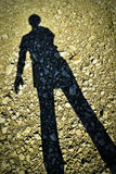 Shadow figures standing on a stone beach Royalty Free Stock Photography