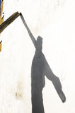 Shadow of fisherman with oars Stock Photos