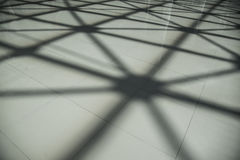 Shadow on the floor from steel structure roof ceiling made of metal and glass Stock Photos