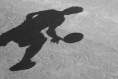 Shadow of a football player Stock Photography