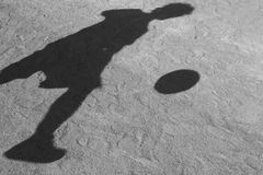 Shadow of a football player Stock Photos