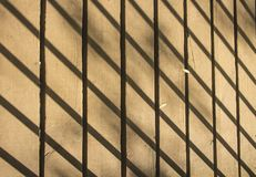 Shadow on footbridge. The shadow of the railing on an old wooden footbridge Royalty Free Stock Images
