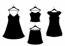 Shadow four clothes on hangers Stock Image