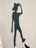 Shadow of girl in hat with bottle Royalty Free Stock Image