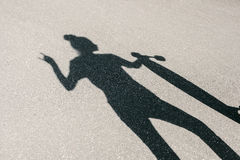 Shadow of girl with a skateboard Stock Photo