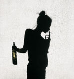 Shadow of girl smoking around on wall background Royalty Free Stock Photography