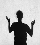 Shadow of girl stretching her hands toward the sky Royalty Free Stock Photo