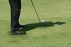 Shadow of golf. Shadow of a golfer with hat stock photo