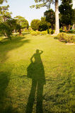 Shadow on grass field Royalty Free Stock Photo