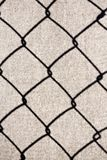 Shadow from the grid on the slate surface. Symmetrical shadow from the metal grid on the surface of the slate plane Stock Photography