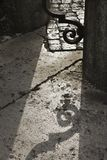 Shadow on ground from iron gate. Royalty Free Stock Photos