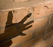 Shadow of hand Stock Images