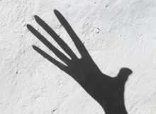 Shadow by hand. On the whitewashed wall Stock Photos