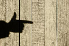 Shadow of a hand with a index finger Royalty Free Stock Photos