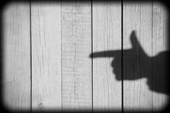 Shadow of a hand with a index finger Royalty Free Stock Photography