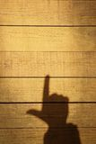 Shadow of a hand with a index finger Stock Image