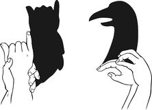 Shadow of hands forming animal head Stock Images