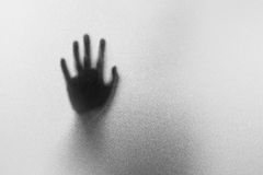 Shadow hands of the Man behind frosted glass.Blurry hand abstrac Royalty Free Stock Images
