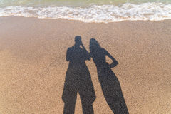 Shadow Of Happy Couple Taking Photos Stock Image