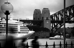 Shadow Harbour. Sydney Harbour Bridge during a cloudy day with a cruise ship awaiting its passengers Royalty Free Stock Photo