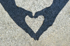 Shadow heart on the stone Stock Image