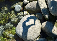Shadow heart on the stone Royalty Free Stock Photography